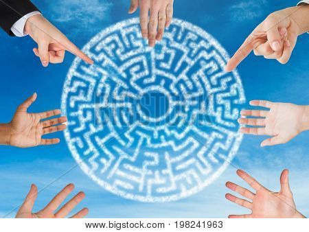Digital composite of Hands in circle around cryptic maze circle in sky