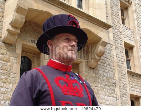 TOWER OF LONDON, UK - AUGUST 24: A yeoman of the guard at the Tower of London in London, England on August 24, 2010. The Beefeaters, Yeoman of the Guard, protect the crown jewels of England.