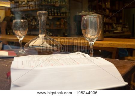 Wine book glasses and decanter on the table