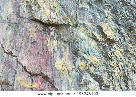 Close Up Of Colorful Rock Surface, Natural Background, Pattern And Texture. Metamorphic White Quartz