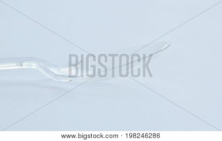 clear and translucent plastic spoon on white background