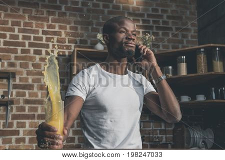 African American Man Talking On Phone