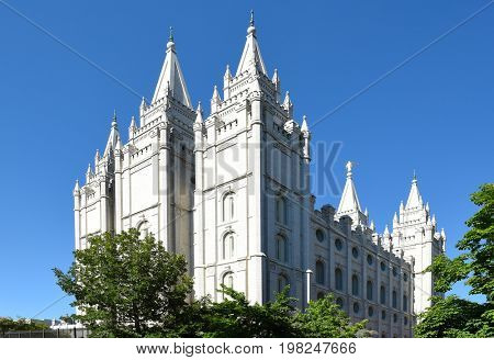 SALT LAKE CITY, UTAH - JUNE 28, 2017: Salt Lake Temple. Built between 1853 and 1893 the temple serves members with sacred ordinances like baptisms and marriages.