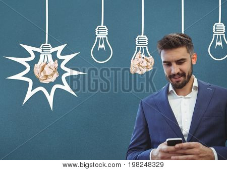 Digital composite of Man on phone standing next to light bulbs with crumpled paper balls