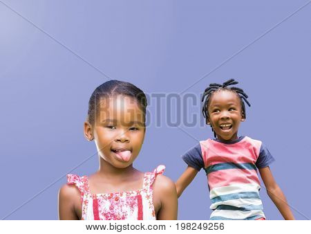Digital composite of kids fooling around playing with blank purple background
