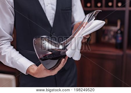 Sommelier With Decanter Of Wine