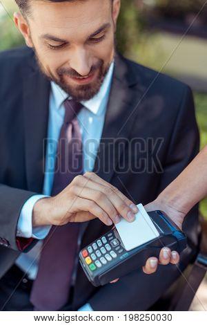 Man Using Contactless Credit Card