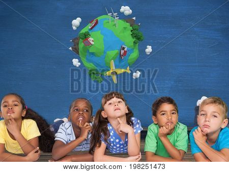 Digital composite of Kids thinking together and blue wall with planet earth world