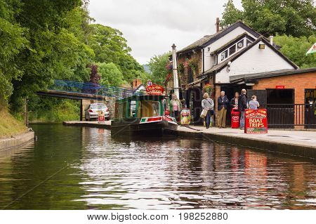Llangollen United Kingdom - August 2 2017: The old wharf in Llangollen now converted to tea rooms and the terminus for horse drawn narrow boat cruise trips along the canal