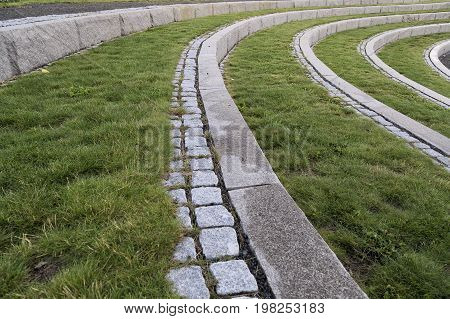 Curved Steps with Stone and Green Grass.