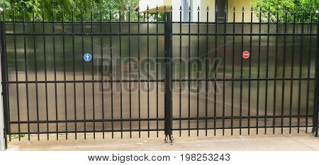 urban residential private property car access gate made from steel tubing and polycarbonate to protect viewer discretion