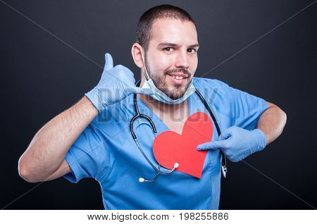 Cardiologist Pointing Red Heart Shape Showing Calling Gesture