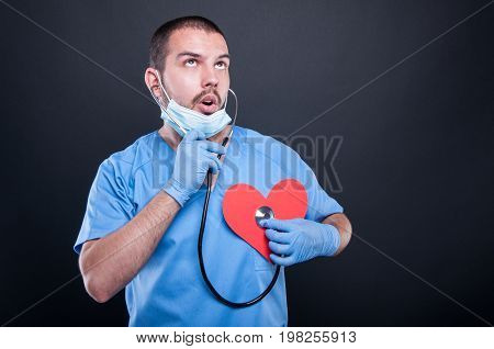 Cardiologist Using Stethoscope On Red Shape Heart