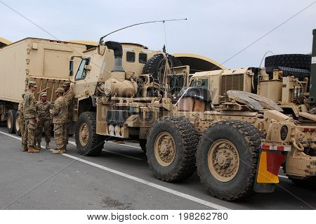 RUSE BULGARIA - JULY 28 2017: US army convoy personnel and military trucks at the Bulgaria-Romania border check point