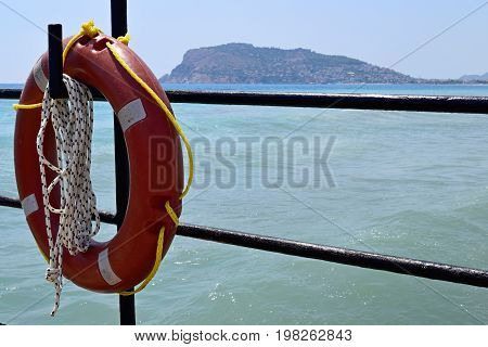 Red lifeline on a background of sea and mountains