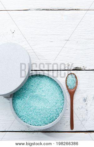 Blue bath salt on table