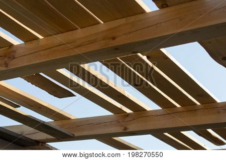 Wooden frame - the beginning of construction of the roof of house