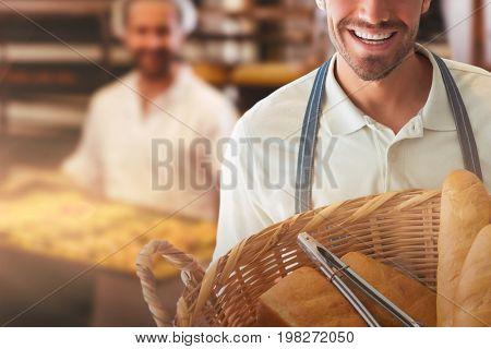 Baker holding bread in whisker basket  against portrait of female baker smiling