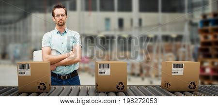 Serious warehouse manager standing with arms crossed against image of a warehouse