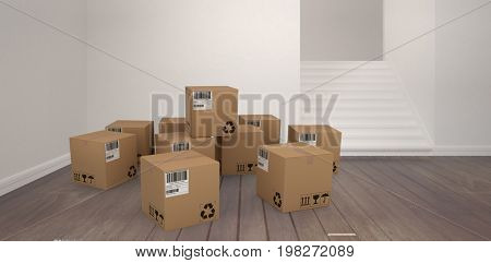 Group of composite cardboard boxes against empty room