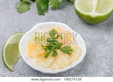Scallops With Lime And Cilantro. Delicious Appetizer Of Seafood. Carpaccio. Sashimi. Selective Focus