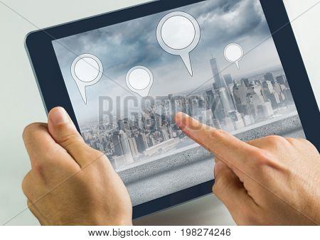 Digital composite of Holding tablet and City with  marker location pointers