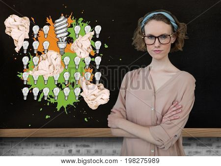 Digital composite of Woman standing next to light bulbs with crumpled paper balls in front of blackboard
