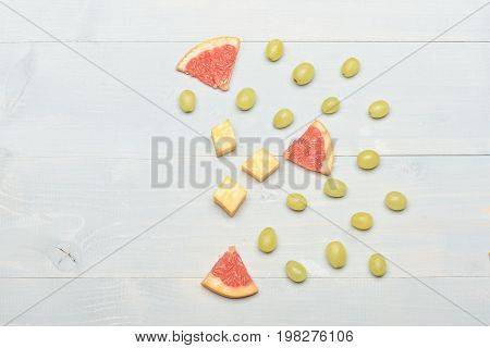Art And Gourmet Food Concept: Grapes, Cheese And Grapefruit