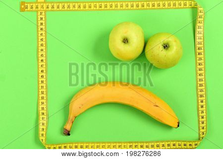 Tape For Measurement Making Frame With Banana And Apple Inside