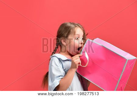 Fashion And Shopaholism Concept. Girl Holds Pink Shopping Bag