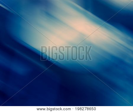 Abstract multicolored diagonal spots blurred background blue