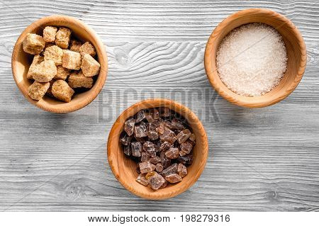 lumps and sanding sugar for cooking sweets on gray kitchen table background top view