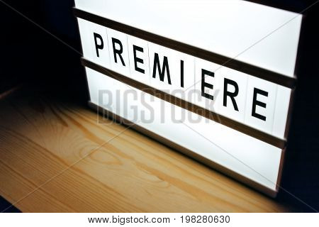 Vintage illuminated lightbox Premiere sign in cinema movie or for radio and television live audience broadcast