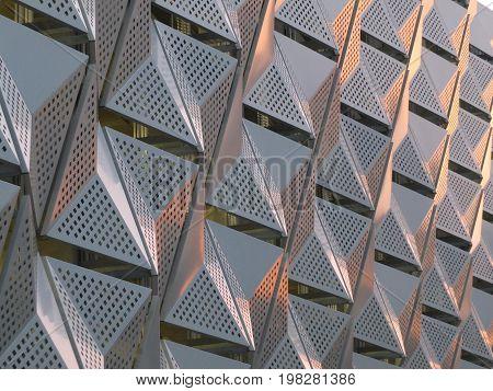 geometric metal cladding with triangular futuristic modern design