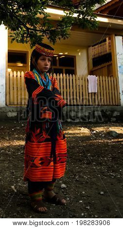 Portrait of Kalash tribe woman in national costume at Joshi fest - 14-05-2015 Bumburet Kunar Pakistan