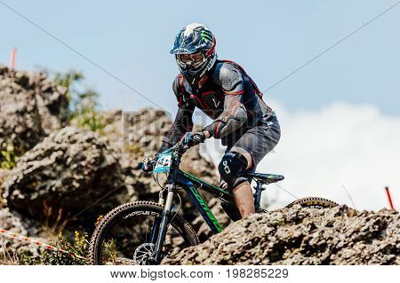 Magnitogorsk Russia - July 21 2017: man rider on bike downhill among stones during National championship downhill