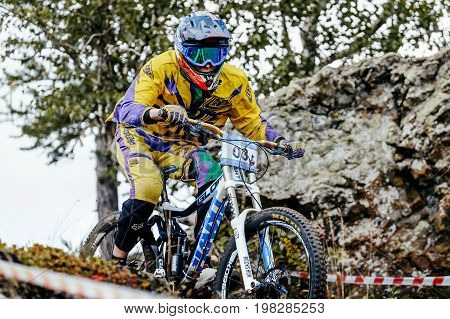 Magnitogorsk Russia - July 21 2017: closeup man rider downhill mountain biking during National championship downhill