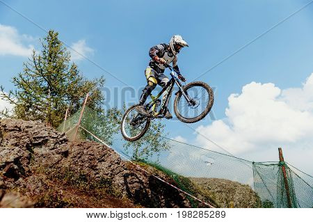 Magnitogorsk Russia - July 21 2017: rider on bike gap jump from mountain during National championship downhill