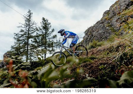 Magnitogorsk Russia - July 21 2017: man rider on bike mountain biking forest track during National championship downhill