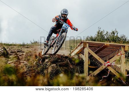 Magnitogorsk Russia - July 22 2017: man rider drops mountain biking during National championship downhill