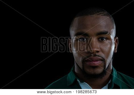 Close up portrait of young male rugby player against white background