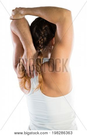 Rear view of female sportsperson exercising while standing against white background