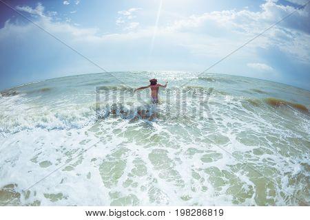 Girl Comes Into The Ocean