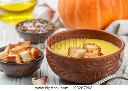 Homemade Pumpkin Cream Soup With Garlic Croutons. A Rustic Style. Selective Focus