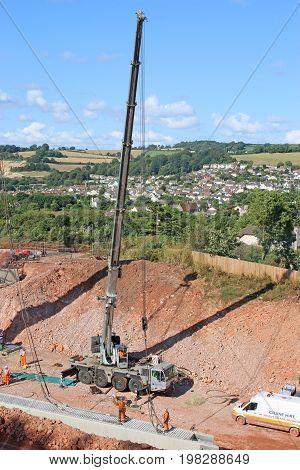 Crane lifting a bridge beam on a construction site