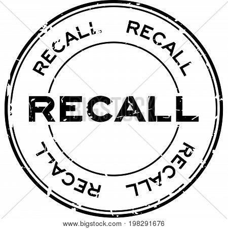 Grunge black recall round rubber seal stamp on white background