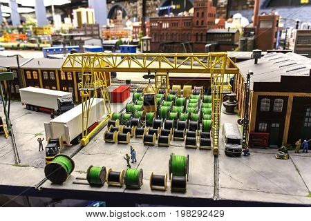 Saint-Petersburg Russia - January 03th 2015: Museum Grand Maket Rossiya - View of the plant for the production of cable. Cable reels in stock. The bootstrap terminal.