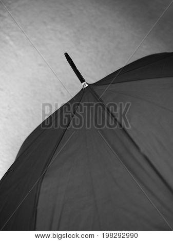 BLACK AND WHITE PHOTO OF CLOSE-UP OF UMBRELLA