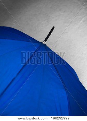 COLOR PHOTO OF CLOSE-UP OF BLUE COLOR UMBRELLA