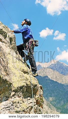 The rock-climber during rock conquest. Rock climbing concept
